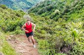 Trail runner running in summer mountain nature landscape on difficult path in mountains in summer wilderness. Athlete jogger working out cardio going up on cross country race uphill outdoors. poster