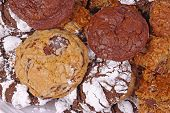 Pile of freshly baked home-made chocolate chip chocolate and chocolate crinkle cookies poster