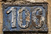Old retro weathered cast iron plate with number 106 poster
