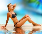 Vacation.Beautiful young woman on the tropical beach poster