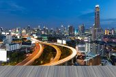 Opeing wooden floor, View of the Bangkok Skyscraper with highway during twilight poster