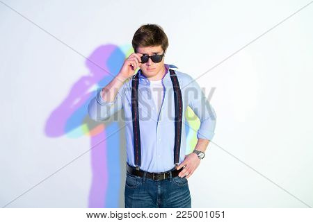 Portrait of self-reliant man in modern clothes looking at camera. Fashion concept