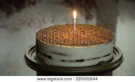 Birthday cake with colorful burning candle in dark. Cake: Birthday Cake With candle For Any Birthday.