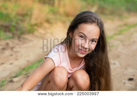 Happy Little girl excited. Cute teen Girl smiling very happy on Summer background.
