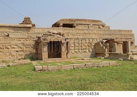 Wall with beautiful bas-reliefs around the Hazara Rama Temple in Hampi, Karnataka, India. Unesco World Heritage Site. The famous tourist destination from GOA.