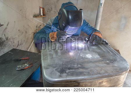 Worker welding the aluminum tank. Argon aluminum welding