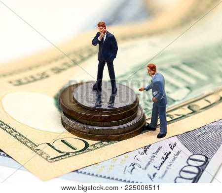 Businessman leader and finance adviser figurines. USA banknote and coin. Business agreement profit. Successful business strategy. Market share growth by merge and acquisitions. Career and leadership