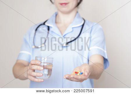 Woman Giving Pills