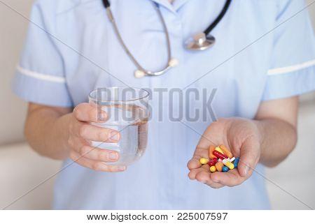 Woman Doctor Giving Pills