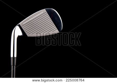 Golf clubhead isolated against a black background