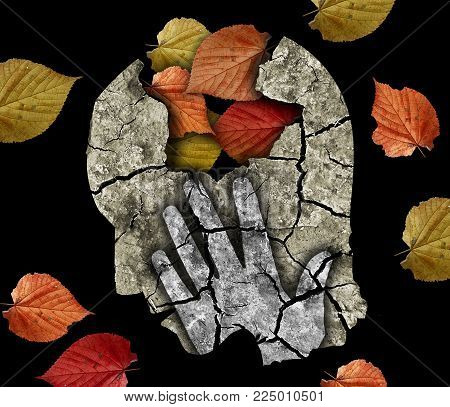 Dementia depression old age. Stylized male hand silhouette holding his head.Photo-montage with Dry cracked earth and autumn leaves symbolizing Depression, old age, dementia.