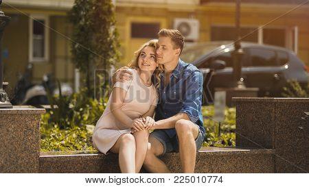 Man in love embracing beautiful blonde girlfriend, couple on romantic date, stock video