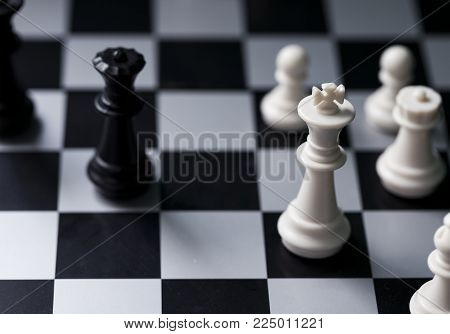 White and black chess figures on board. Chess game position. Black and white king. Pawns and rook on chessboard. Chess figurine order. Checkmate game banner template. Intellectual sport. Tactic game