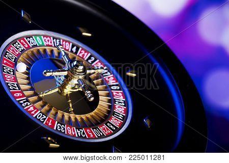 Casino Theme. Gambling Games. Closeup Of The Roulette Wheel.