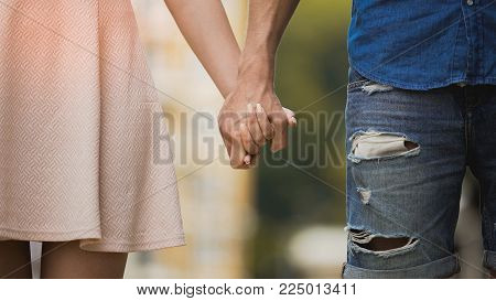 Young woman and man holding hands, tender relationship of sweet couple, love, stock video