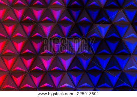 color pallet, illumination, decor concept. multicolored background of the stage in modern theater created with lots of pyramids made of cardboard and illuminated from below