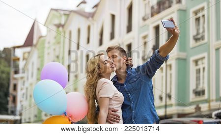 Young couple in love kissing and taking selfie, romantic memories, happiness, stock video