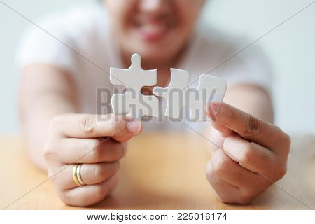Asian Woman Jointing Jigsaw Puzzle Shallow Depth Of Field Select Focus On Hands