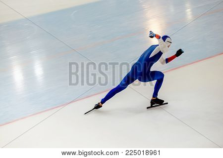 fast running athlete speed skater on ice sport arena