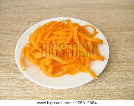 Low carb carrot noodles on white plate