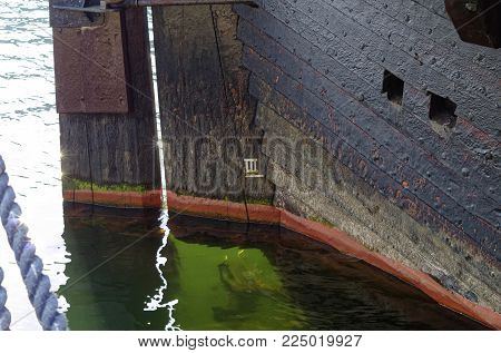 Old historic wooden ship laid out in Warnemünde in the harbor at the Baltic Sea in Germany