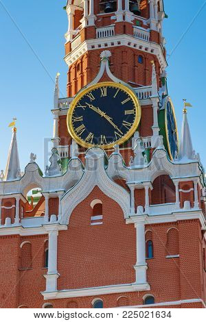 Moscow, Russia - February 01, 2018: Chimes clock of the Spasskaya Tower of Moscow Kremlin closeup. Moscow Kremlin in winter