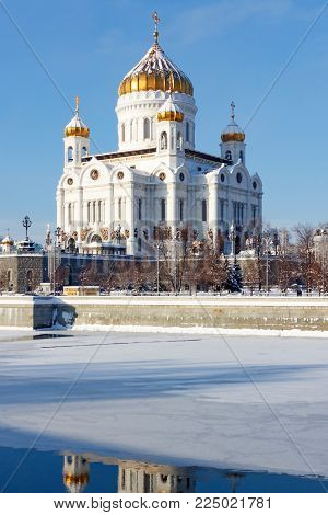 Moscow, Russia - February 01, 2018: Cathedral of Christ the Saviour on Moskva river background in sunny winter day. Moscow in winter