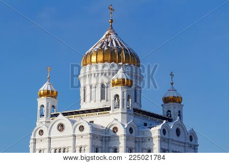 Moscow, Russia - February 01, 2018: Cathedral of Christ the Saviour with golden domes in Moscow on a blue sky background at sunny winter day