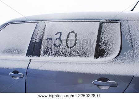 Passenger Car, Covered With Snow In A Strong Frost. Minus 30 Degrees To The North