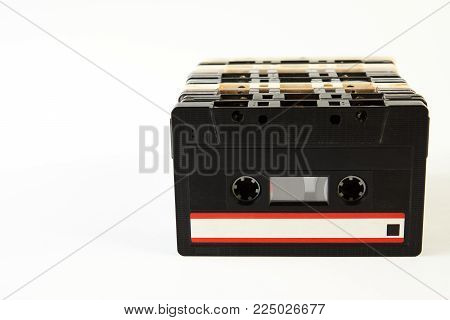 Vintage audio cassette tape. ollection of retro cassette tapes isolated on a white background with copy space, close-up. Tape and audio, music and sound, media and record