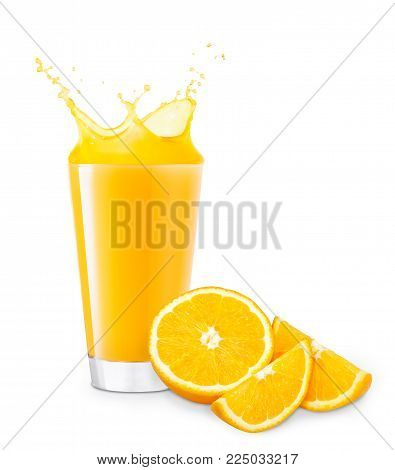 glass of splashing orange juice with cutting orange fruit isolated on white background. Orange juice splash