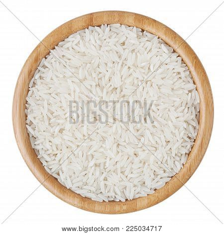 Top view of white long-grain rice in wooden bowl isolated on white background with clipping path