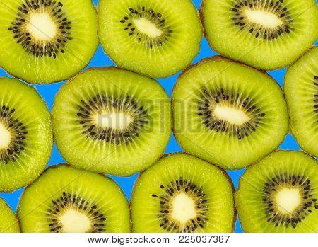 Kiwi fruit.  Slice of fresh kiwi fruit isolated. Background