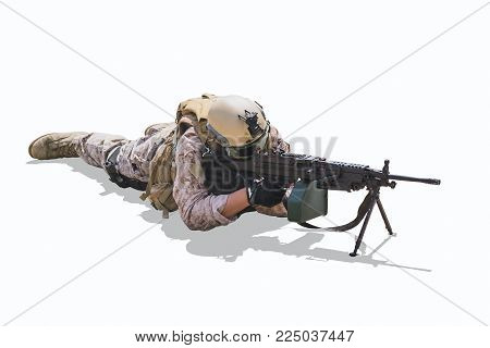 military army soldier lies prone on a firing Machine Gun isolated on white