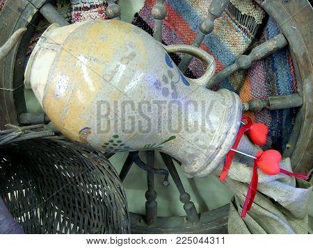 Ethnic motive, jug and red heats, wheel