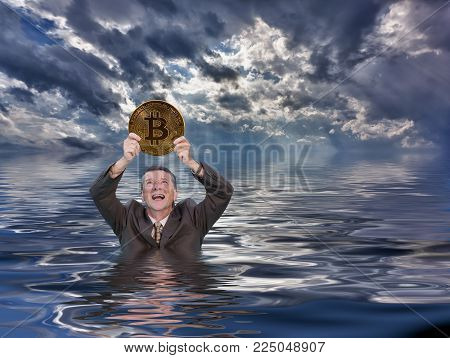 Senior man angry and holding bitcoin as he sinks into water after investing in the cybercurrency