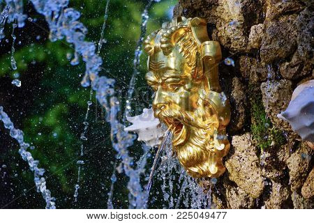 Golden Mask On The Fountain In The Summer Garden Of St. Petersburg