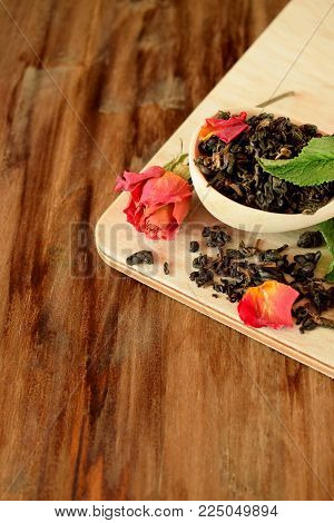 Leaf tea, dried rose and fresh mint for making a hot drink