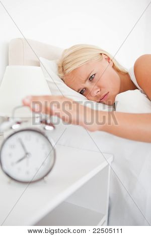 Portrait Of An Unhappy Woman Awaken By An Alarmclock