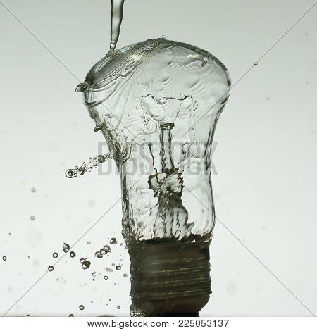 Light Bulb Made Of Water Splashes