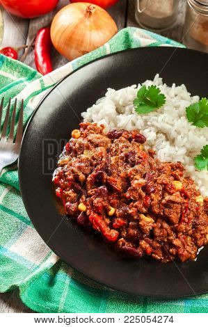 Hot Chili Con Carne With Ground Beef, Beans, Tomatoes And Corn Served With Rice