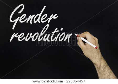 chalk drawing concept 2018. Person's hand drawing with chalk on blackboard - Gender revolution