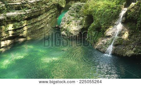 Beautiful waterfall in green forest in jungle. Waterfall in the mountains. Tropical rain forest with waterfall. Philippines, Cebu. Travel concept.