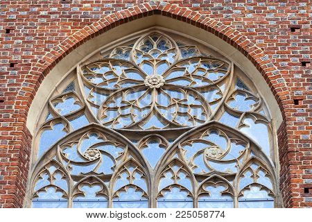 13th century Gothic Collegiate Church of the Holy Cross and St. Bartholomew,ornamental window, Ostrow Tumski, Wroclaw, Poland.  It is a two-storey brick church on the Cathedral Island