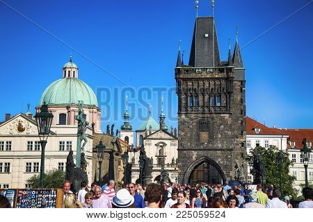 PRAGUE, CZECH REPUBLIC - AUGUST 24, 2016: People walking and look around Old Town Bridge Tower (Stare Mesto Tower) and  Charles Bridge (Karluv Most) in Prague, Czech Republic