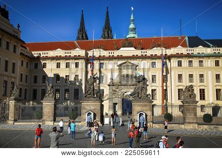 PRAGUE, CZECH REPUBLIC - AUGUST 24, 2016: People walking and look around Prague castle located in Hradcany district in Prague, Czech Republic