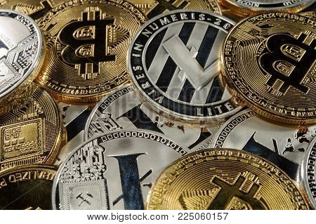 Mix of bitcoins, litecoins and ethereum coins. Cryptocurrency concept. Real photo. Luxury background.