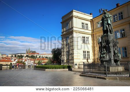 PRAGUE, CZECH REPUBLIC - AUGUST 23, 2016: People walking and look around Karol Quarto statue and view on St. Vitus Cathedral in Prague, Czech Republic