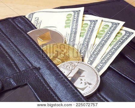 Bitcoin. Bitcoins with dollars in a black purse. Golden bitkoyny digital virtual money. Metal gold money by bit Credit coins - bitkoyn BTK , lithecoyne LTC , ether ETH digital cryptococci
