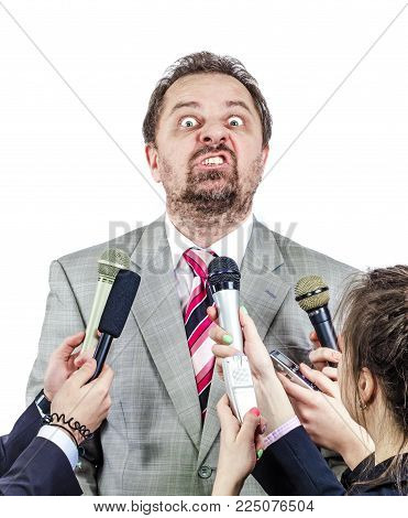 Mature nervous politician gives interview to journalists
